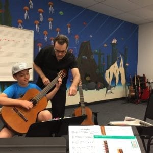 Guitar Teacher and Student in a studio, taking a lesson